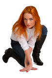 Beautiful red-haired girl in a white blouse Royalty Free Stock Photo