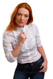 Beautiful red-haired girl in a white blouse Royalty Free Stock Images