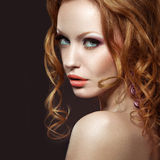 Beautiful Red-haired Girl With Bright Makeup And Curls.