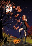 Beautiful red-haired Halloween witch. royalty free stock photography