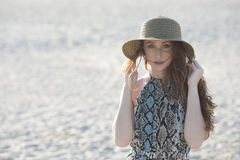Beautiful red haired model on beach - fashion Royalty Free Stock Images
