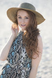 Beautiful red haired model on beach - fashion Stock Photo
