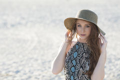 Beautiful red haired model on beach - fashion Stock Photography