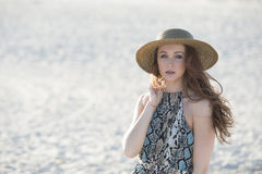 Beautiful red haired model on beach - fashion Stock Image