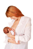 Beautiful red-haired mom and baby. Royalty Free Stock Images