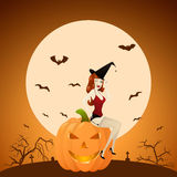 Beautiful red-haired PinUp witch on pumpkin Stock Images