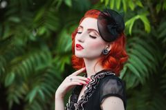 Beautiful red-haired retro girl with clean healthy skin and blue eyes. Fashion vintage model stock images