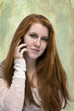 Beautiful red haired teen with phone Royalty Free Stock Photography
