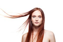 Beautiful red haired with windy hair Royalty Free Stock Image