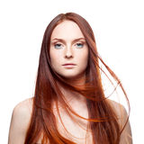 Beautiful red haired with windy hair Royalty Free Stock Photo