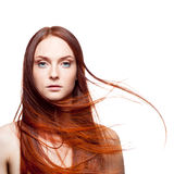 Beautiful red haired with windy hair Royalty Free Stock Images