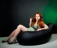 Beautiful red haired woman Stock Image