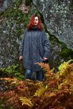 Beautiful red-haired woman in autumn. In the park Stock Photos