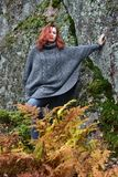 Beautiful red-haired woman in autumn. In the park Stock Image