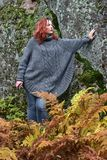 Beautiful red-haired woman in autumn. In the park Royalty Free Stock Photos