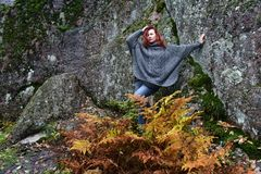 Beautiful red-haired woman in autumn. In the park Royalty Free Stock Photography