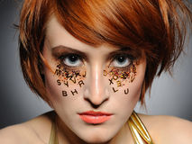 Beautiful red haired woman with creative make-up Stock Photo