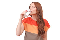 Beautiful red-haired woman drinking water Stock Photos