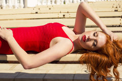 Beautiful red haired woman in elegant dress Stock Images