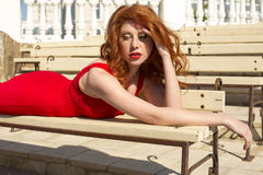 Beautiful red haired woman in elegant dress Royalty Free Stock Photos
