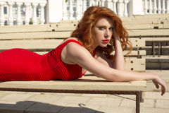beautiful red haired woman elegant dress hair freckles lying bench summer park 40611529
