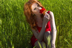 Beautiful red haired woman enjoying life Stock Photography
