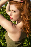 Beautiful red haired woman enjoying life Royalty Free Stock Image