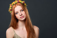 Beautiful red haired woman in flower wreath. Closeup of beautiful red haired woman in flower wreath Royalty Free Stock Photography