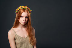 Beautiful red haired woman in flower wreath. Closeup of beautiful red haired woman in flower wreath Royalty Free Stock Photos