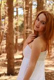 Red haired woman in a forest Royalty Free Stock Photo