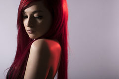 Beautiful red haired woman posing over grey. Woman with Red Hair. Young Fashion Girl Portrait Royalty Free Stock Image