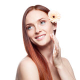 Beautiful red haired woman touching skin Stock Photo