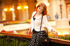 Beautiful red-haired woman. Walking in the mall Stock Photo