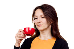 beautiful red-haired young woman with cup of tea on white background royalty free stock photos