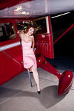 Beautiful red head arrives in style Stock Photo