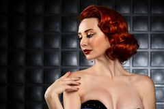 Beautiful Red Head Pinup Fashion Model on Styled Set Stock Photography