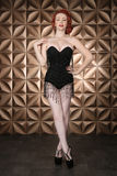Beautiful Red Head Pinup Fashion Model on Styled Set Stock Image