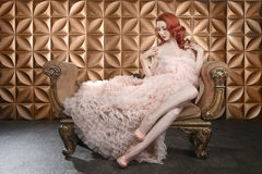 Beautiful Red Head Pinup Fashion Model on Styled Set Stock Images