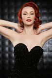 Beautiful Red Head Pinup Fashion Model on Styled Set Royalty Free Stock Image