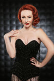 Beautiful Red Head Pinup Fashion Model on Styled Set Stock Photo
