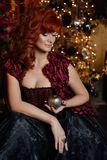 Red head witch in evening dress Royalty Free Stock Photos