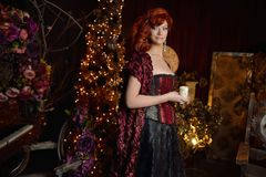 Red head witch in evening dress Royalty Free Stock Image