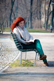 Beautiful red head young woman reading book Stock Photos
