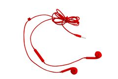 Beautiful red headphones for smartphones, tablets, music players and a computer with a headset, on a white isolated background. Horizontal frame stock photos