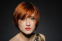 Beautiful red heaired woman with fashion hairstyle Royalty Free Stock Photography