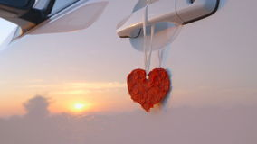 Beautiful Red Heart Hanging on a Door Handle of a Car - camera pan stock video