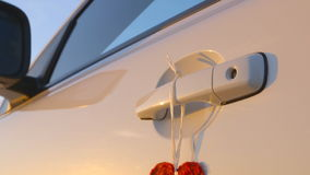 Beautiful Red Heart Hanging on a Door Handle of a Car - camera pan stock footage