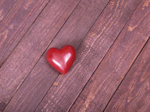 Beautiful red heart isolated on wooden background Stock Photos
