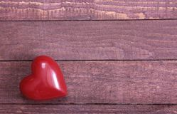 Beautiful red heart isolated on wooden background Royalty Free Stock Images