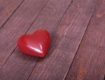 Beautiful red heart isolated on wooden background Royalty Free Stock Image